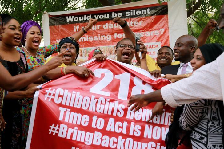 Members of the #BringBackOurGirls (#BBOG) campaign react on the presentation of a banner which shows ''218'', instead of the previous ''219'', referring to kidnapped Chibok school girls, during a sit-out in Abuja, Nigeria May 18, 2016, after receiving news that a Nigerian teenager kidnapped by Boko Haram from her school in Chibok more than two years ago has been rescued. REUTERS/Afolabi Sotunde/Files