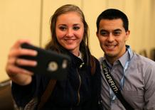 Millennial stock blogger and trader Rachel Fox, 20, is asked to take a picture with a fan after speaking to a group of investors, tech nerds and stock traders at StockTwits annual Stocktoberfest in Coronado, California, U.S. October 14, 2016. Picture taken October 14, 2016.    REUTERS/Mike Blake