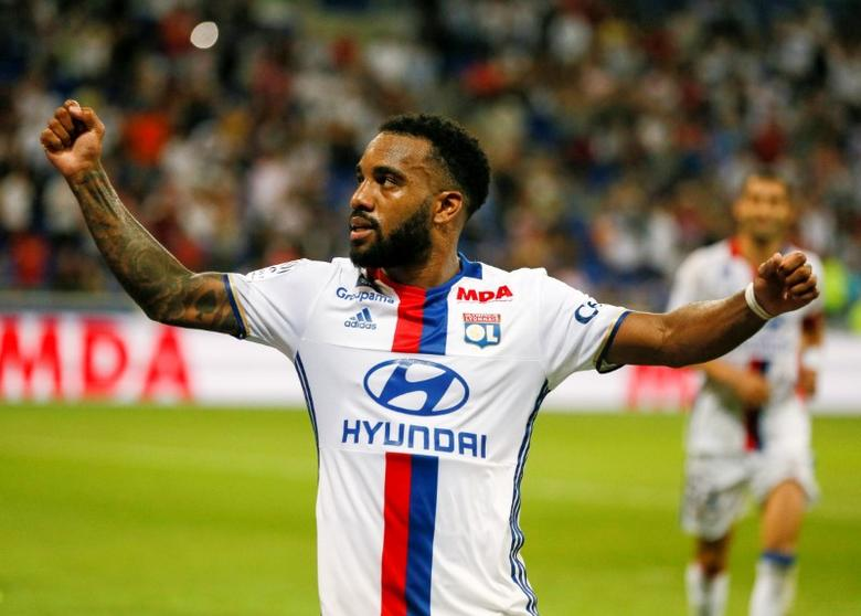 Football Soccer - Olympique Lyon v Caen - French Ligue 1 - Grand Stade stadium, Decines, France - 19/8/2016 Olympique Lyon's Alexandre Lacazette after scoring a penalty against Caen  REUTERS/Robert Pratta