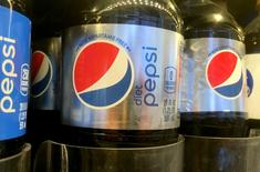 Pepsi bottles are seen lined up at a store in New York, U.S. July 5, 2016. REUTERS/Shannon Stapleton