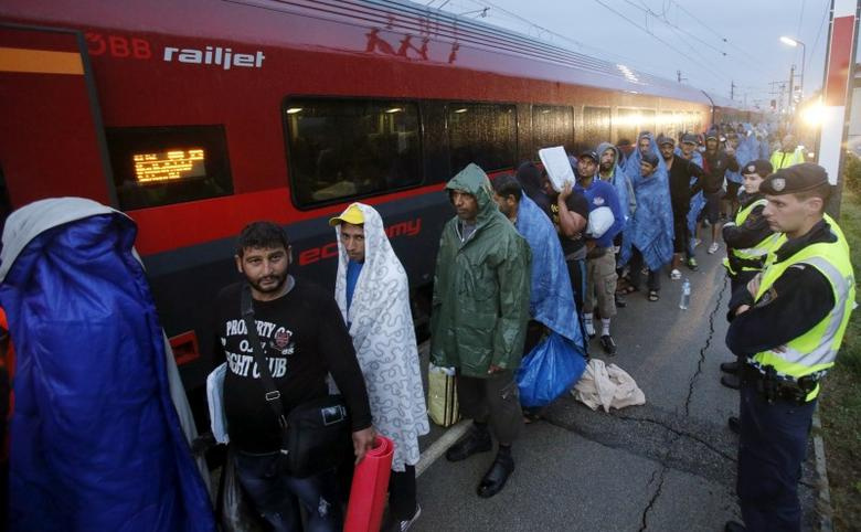 Migrants arrive at the Austrian train station of Nickelsdorf to board trains to Germany, September 5, 2015. REUTERS/Heinz-Peter Bader/Files
