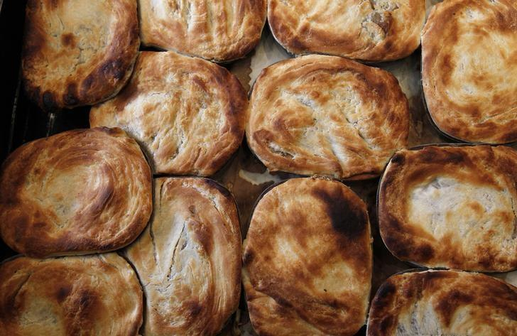 Meat pies are pictured in a shop in London June 1, 2012. REUTERS/Suzanne Plunkett/Files