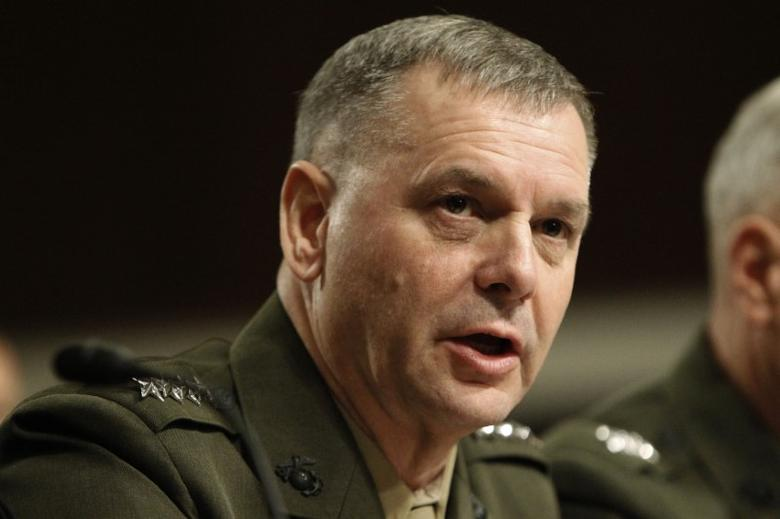 FILE PHOTO - General James E. Cartwright, former USMC vice chairman of the Joint Chiefs of Staff, testifies before the Senate Armed Services Committee hearing on a repeal of section 654 of title 10, United States Code, ''Policy Concerning Homosexuality in the Armed Forces'' on Capitol Hill in Washington December 3, 2010. REUTERS/Hyungwon Kang