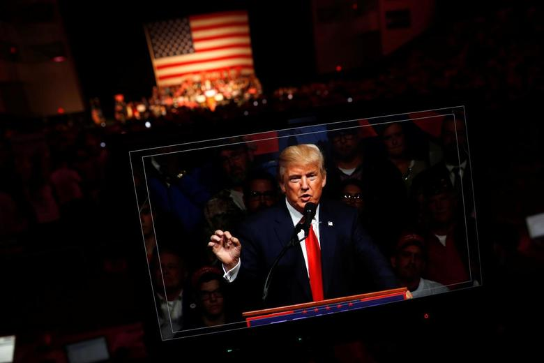 Republican presidential nominee Donald Trump appears on a video screen as he holds a rally with supporters in Bangor, Maine, U.S. October 15, 2016. REUTERS/Jonathan Ernst