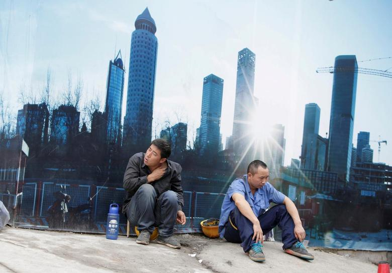 Workers rest outside a construction site in Beijing's central business district, China, July 15, 2016. REUTERS/Jason Lee/File Photo
