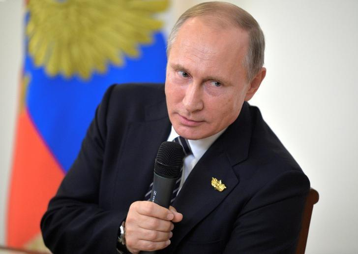 Russian President Vladimir Putin speaks during a news conference following the BRICS (Brazil, Russia, India, China and South Africa) Summit in the western state of Goa, India, October 16, 2016. Sputnik/Kremlin/Alexei Druzhinin via REUTERS