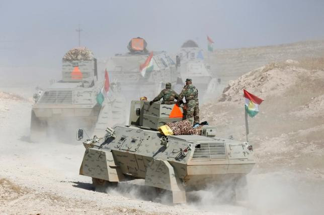 Peshmerga forces advance in the east of Mosul to attack Islamic State militants in Mosul. REUTERS/Thaier Al-Sudani