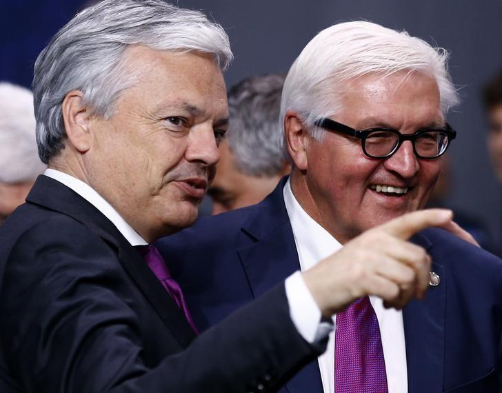 Belgium's Minister of Foreign Affairs Didier Reynders (L) speaks to German Foreign Minister Frank-Walter Steinmeier at the NATO Summit in Warsaw, Poland July 8, 2016.  REUTERS/Kacper Pempel/Files