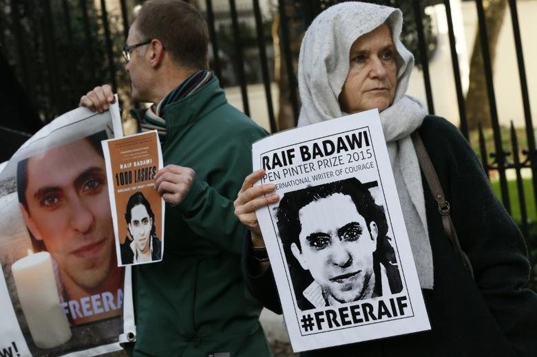 Demonstrators hold placards during a protest for Saudi blogger Raif Badawi, outside the Saudi Arabian Embassy in London, Britain January 8, 2016.   REUTERS/Stefan Wermuth