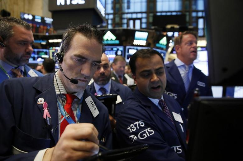 Traders work on the floor of the New York Stock Exchange (NYSE) shortly after the opening bell in New York, U.S., October 17, 2016.  REUTERS/Lucas Jackson
