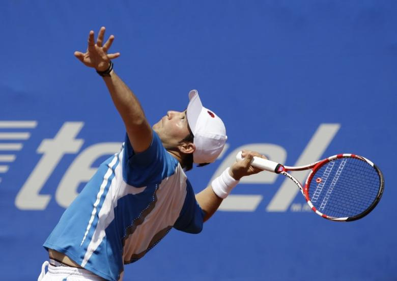 Daniel Garza of Mexico serves to Lukasz Kubot of Poland during their men's singles match at the Acapulco International Mexican Open tennis tournament in Acapulco in this file photo dated February 28, 2012. REUTERS/Henry Romero