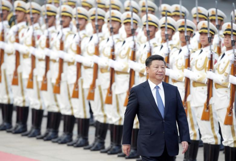 China's President Xi Jinping reviews honour guards during a welcoming ceremony for Peru's President Pedro Pablo Kuczynski (not in picture) at the Great Hall of the People in Beijing, China, September 13, 2016. REUTERS/Jason Lee