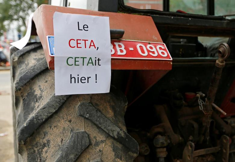 A sign reading ''The CETA was yesterday!'' is seen on a tractor outside the Walloon regional parliament as deputies attend a debate on the Comprehensive Economic and Trade Agreement (CETA), a planned EU-Canada free trade agreement, in Namur, Belgium, October 14, 2016. REUTERS/Francois Lenoir