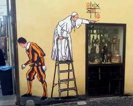 A graffiti depicting Pope Francis and a Swiss guard is seen in Borgo Pio, in Rome, Italy, October 19, 2016. REUTERS/Stringer