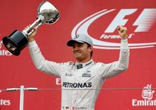 Mercedes' driver Nico Rosberg of Germany celebrates winning the race. REUTERS/Toru Hanai