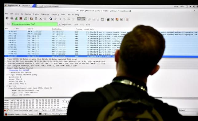 An attendee looks at a monitor at the Parsons booth during the 2016 Black Hat cyber-security conference in Las Vegas, Nevada, U.S. August 3, 2016.  REUTERS/David Becker
