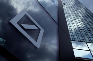 A Deutsche Bank logo adorns a wall at the company's headquarters in...
