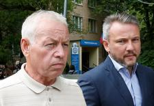 Former driver of a snow plow at Vnukovo airport and suspect Vladimir Martynenko (L), walks after attending a preliminary hearing on the air accident, which resulted in the death of Christophe de Margerie, the chief executive of Total company, at the Solntsevo District Court on the suburbs of Moscow, Russia, July 14, 2016. REUTERS/Sergei Karpukhin