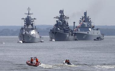 Russian navy ships are anchored in bay of Russian fleet base in Baltiysk in...