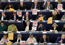 "Members of the Confederal Group of the European United Left of the European Parliament display posters with the words ""stop CETA"" as they take part in a voting session at the European Parliament in Strasbourg, France, October 26, 2016. REUTERS/Vincent Kessler"