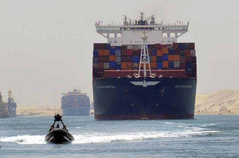 A cargo ship is seen crossing through the New Suez Canal, Ismailia, Egypt, July 25, 2015.  REUTERS/Stringer/File Photo