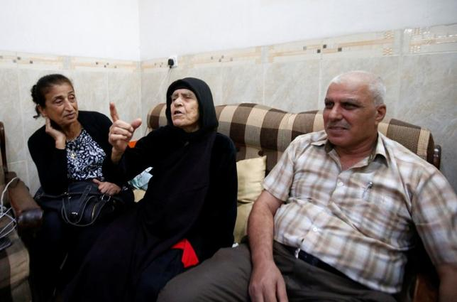 Zarifa Badoos Daddo (C), 77, speaks during an interview with Reuters in Erbil, Iraq. Zarifa was reunited with her family on Sunday after Iraqi forces drove Islamic State from the town of Qaraqosh, southeast of Mosul. REUTERS/Azad Lashkari