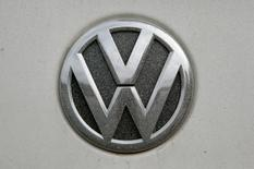 A Volkswagen (VW) logo covered with dust is seen at a car in Grafenwoehr, Germany, October 26, 2016. REUTERS/Michaela Rehle