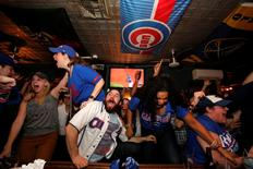 Fans of National League baseball team Chicago Cubs gathered to watch the game at Kelly's bar celebrate their Major League Baseball World Series game 7 victory against American League's Cleveland Indians in Manhattan, New York U.S., November 3, 2016.  REUTERS/Andrew Kelly