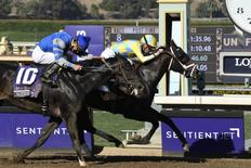 Nov 5, 2016; Santa Anita, CA, USA; Robby Alvarado on Not This Time follows the winning Julien Leparouz on Classic Empire in race eight during the 33rd Breeders Cup world championships at Santa Anita Park. Mandatory Credit: Richard Mackson-USA TODAY Sports
