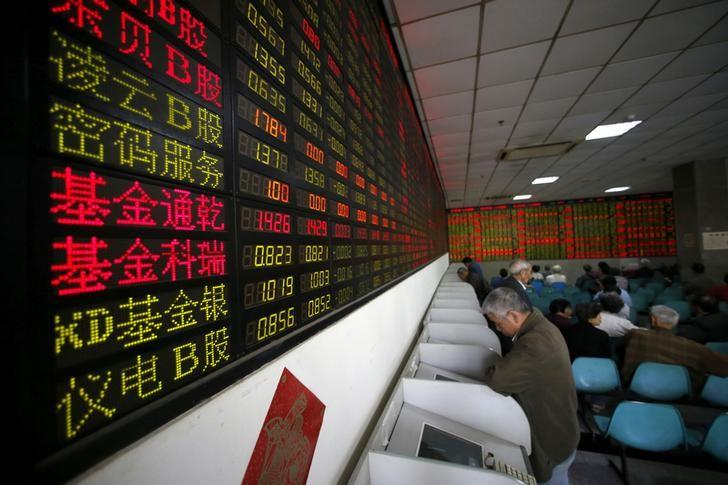 Investors look at computer screens showing stock information at a brokerage house in Shanghai, China, April 21, 2016. REUTERS/Aly Song/File Photo