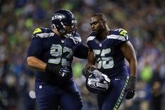 Nov 7, 2016; Seattle, WA, USA; Seattle Seahawks defensive end Cliff Avril (56) is greeted by defensive tackle Sealver Siliga following a turnover on downs against the Buffalo Bills fourth quarter at CenturyLink Field. Mandatory Credit: Joe Nicholson-USA TODAY Sports