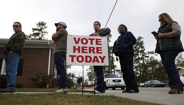 People wait in line to cast their ballots at the Aynor Town Hall during the U.S. presidential election in Aynor, South Carolina, U.S. November 8, 2016.  REUTERS/Randall Hill