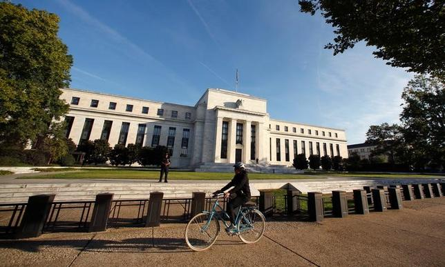 A cyclist passes the U.S. Federal Reserve in Washington October 12, 2016. REUTERS/Kevin Lamarque