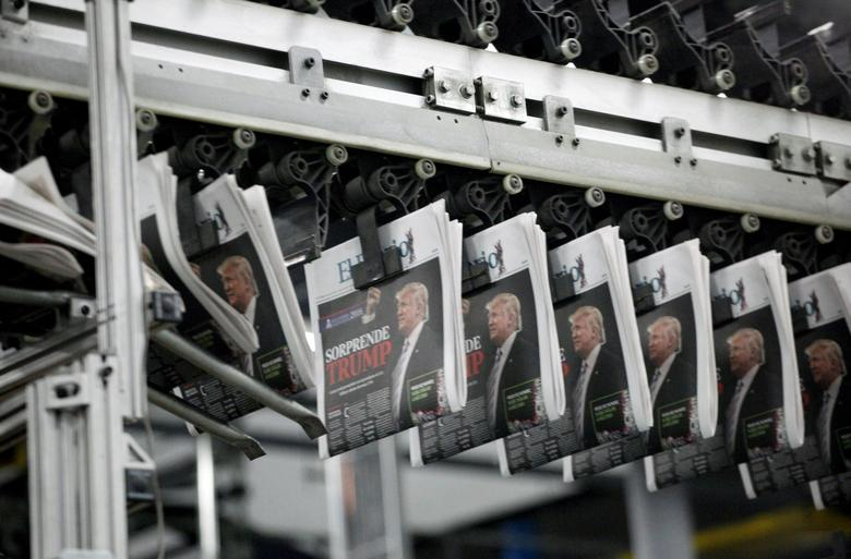 Freshly printed newspapers with the headline reading ''Trump surprises'' are seen at a conveyer belt at a printer of the local daily El Diario of Juarez in Ciudad Juarez, Mexico, November 9, 2016. REUTERS/Jose Luis Gonzalez