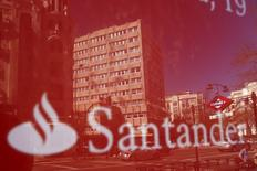 Buildings are reflected on a logo of a Santander bank branch in central Madrid, Spain, April 6, 2016. REUTERS/Juan Medina