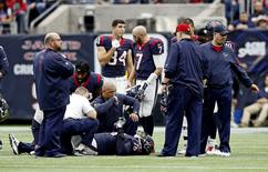 Houston Texans tackle Duane Brown is examined by team medical staff after being injured during the first half against the Jacksonville Jaguars at NRG Stadium in Houston, Texas, U.S. January 3, 2016.   Mandatory Credit: Kevin Jairaj-USA TODAY Sports/File Photo