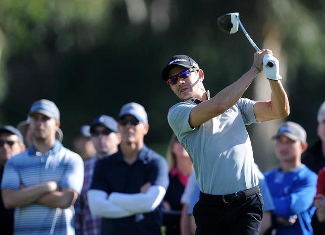 11月20日、米男子ゴルフのRSMクラシックは最終ラウンドを行い、26位タイでスタートした岩田寛は36位タイに順位を落として終えた。写真はプレーオフで優勝を争うカミロ・ビジェガス(2016年 ロイター/Gary A. Vasquez-USA TODAY Sports)
