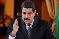 El presidente de Venezuela, Nicolás Maduro, en una rueda de prensa en Caracas, nov 4, 2016. El presidente de Venezuela, Nicolás Maduro, dijo el martes que su gobierno evaluará iniciar acciones judiciales contra el estadounidense JPMorgan, luego de que el banco reportara en la víspera que la petrolera estatal PDVSA retrasó hasta por 30 días el pago de unos intereses de sus bonos.    REUTERS/Marco Bello