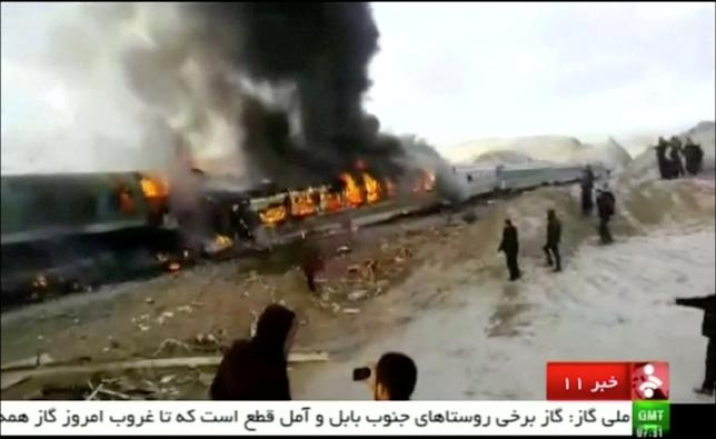 People gather around two passenger trains that collided in the city of Shahroud, in the north-central province of Semnan, killing several people, in this still frame taken from video, November 25, 2016. IRINN/ via REUTERS TV