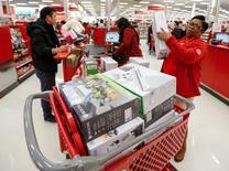 Store employee helps a customer with his purchase during the Black Friday sales event on Thanksgiving Day at Target in Chicago, Illinois, U.S., November 24, 2016. REUTERS/Kamil Krzaczynski