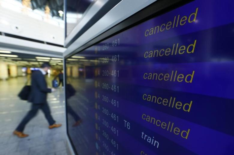 A passenger walks past a flight information board showing cancelled flights during a pilots strike of German airline Lufthansa at  Frankfurt airport, Germany, November 23, 2016. REUTERS/Ralph Orlowski