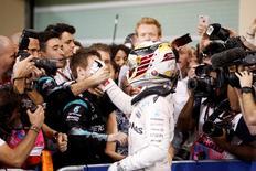Formula One - F1 - Abu Dhabi Grand Prix - Yas Marina Circuit, Abu Dhabi, United Arab Emirates - 27/11/2016 - Mercedes' Formula One driver Lewis Hamilton of Britain celebrates after winning the race. REUTERS/Hamad I Mohammed