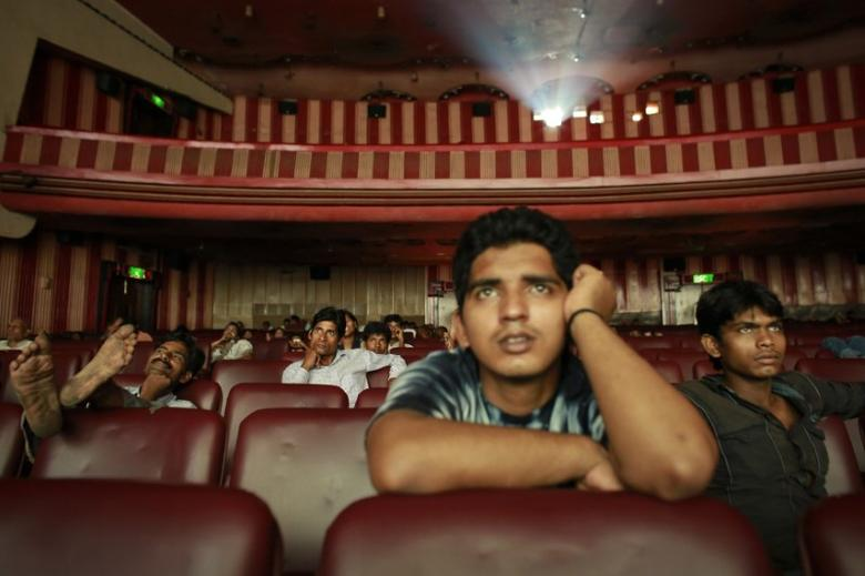 Ram Pratap Verma, a 32-year-old aspiring Bollywood film actor, watches a film at a cinema in Mumbai May 2, 2013. REUTERS/Danish Siddiqui