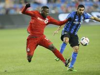 Nov 30, 2016; Toronto, Ontario, CAN; Toronto FC midfielder Brian James (36) battles for the ball with Montreal Impact defender V?ctor Cabrera (36) in the second leg of the MLS Eastern Conference Championship at BMO Field. Mandatory Credit: John E. Sokolowski-USA TODAY Sports
