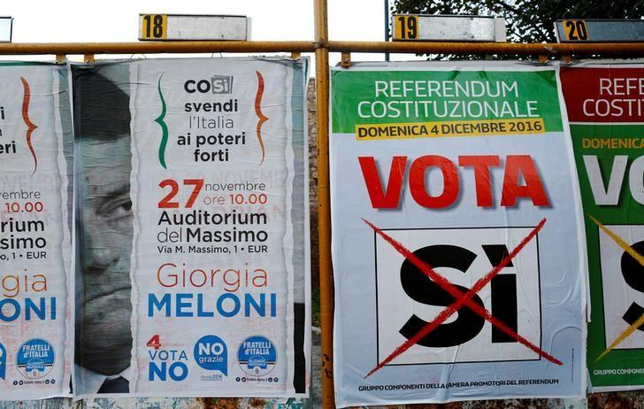 Posters in support of the 'Yes' vote in the upcoming constitutional reform referendum are seen in Rome, Italy November 30, 2016. REUTERS/Tony Gentile