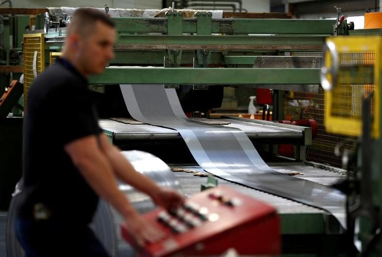 A worker at perforating company Bion uses a machine at the factory in Reading, Britain September 22, 2016.   REUTERS/Peter Nicholls/File Photo