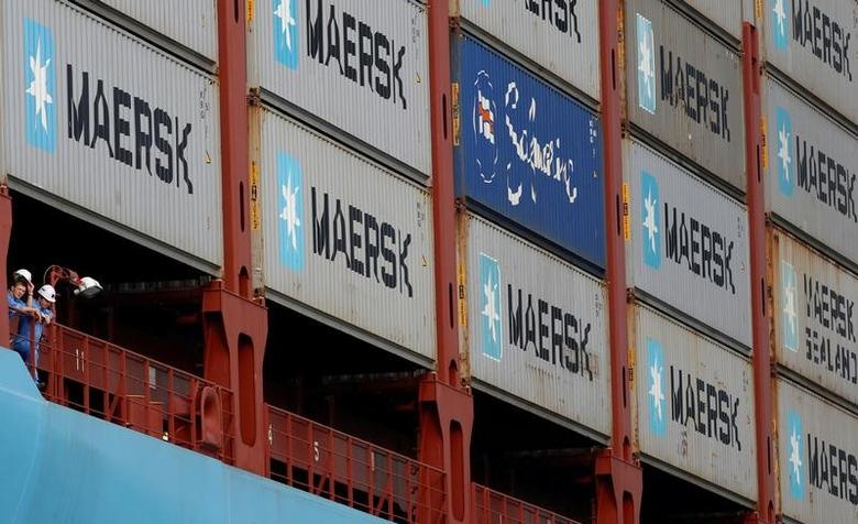 Crew members look out from the MV Maersk Mc-Kinney Moller as it berths at a PSA International port terminal in Singapore, September 27, 2013.     REUTERS/Edgar Su/File Photo