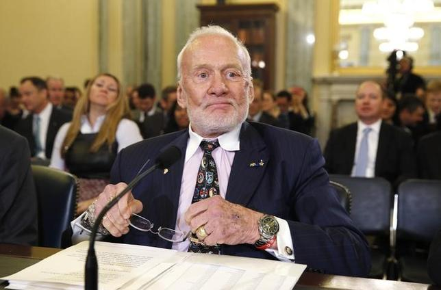 Former astronaut Buzz Aldrin takes his seat to testify before a Senate Subcommittee on Space, Science, and Competitiveness hearing, entitled ''U.S. Human Exploration Goals and Commercial Space Competitiveness,'' on Capitol Hill in Washington, February 24, 2015. REUTERS/Kevin Lamarque