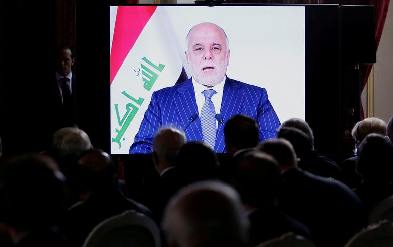 Iraqi Prime Minister Haider al-Abadi is seen on a screen as he speaks via a videoconference during a ministerial summit to hold discussion on the future of Mosul city, post-Islamic State, in Paris, France, October 20, 2016.   REUTERS/Regis Duvignau/File Photo