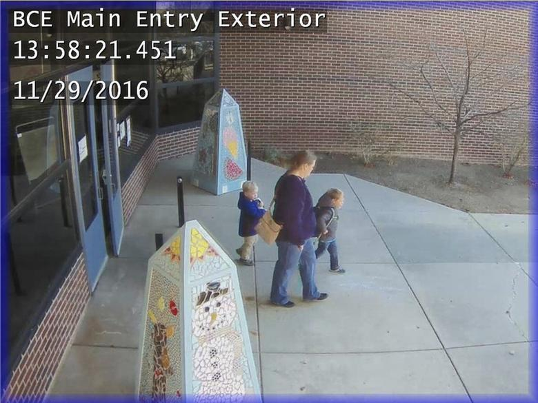 Jennifer Marie Laber and her sons Adam and Ethan are seen in this Douglas County Sheriff's Office image from a surveillance camera at the Bear Canyon Elementary School in Highlands Ranch, Colorado, U.S. on November 29, 2016.  Courtesy Douglas County Sheriff's Office/Handout via REUTERS